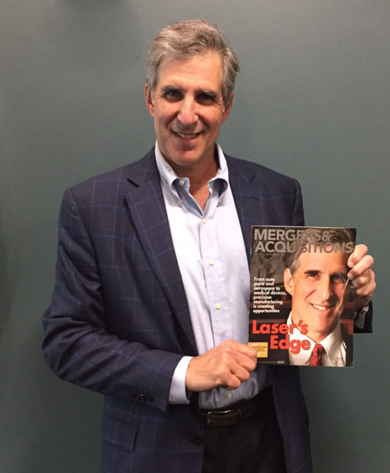 Steven Karol of Watermill Group holds a copy of the Mergers & Acquisitions magazine he is featured in