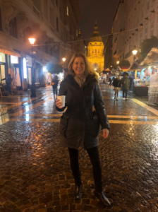 Tracy Streckenbach holding a coffee on a diligence trip